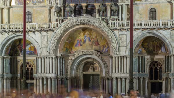 Entrance to Basilica of St Mark night timelapse. It is cathedral church of Roman Catholic Archdiocese of Venice. It lies at Piazza San Marco. Tourists walking in front of it. First St Mark's was constructed in 828. Venice, Italy Royalty-free stock video