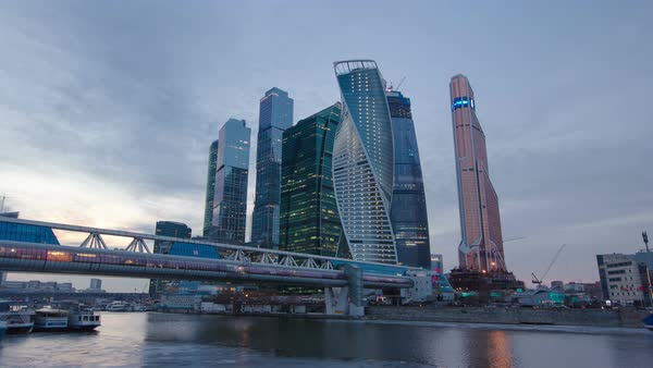 Skyscrapers International Business Center City at night with Moscow river and Bagration bridge day to night transition timelapse hyperlapse, Moscow, Russia Royalty-free stock video