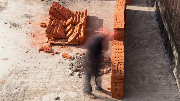 Construction mason worker bricklayer installing red brick on moscow metro building timelapse Royalty-free stock video