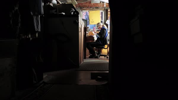Wide shot of a goldsmith working in a studio Royalty-free stock video