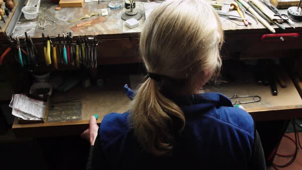Close up shot of a goldsmith using a workbench Royalty-free stock video