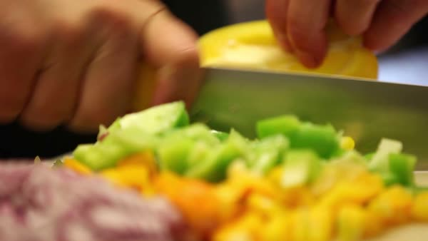 Close-up of hands cutting vegetables. Person cutting veggies Royalty-free stock video