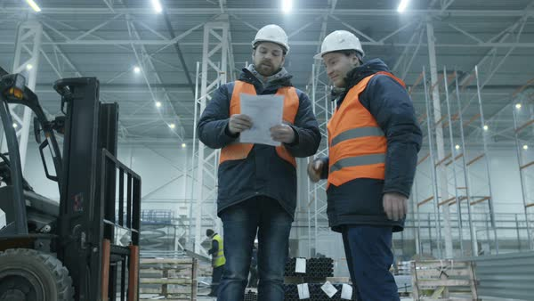 Engineers giving handshake in new modern industry warehouse Royalty-free stock video