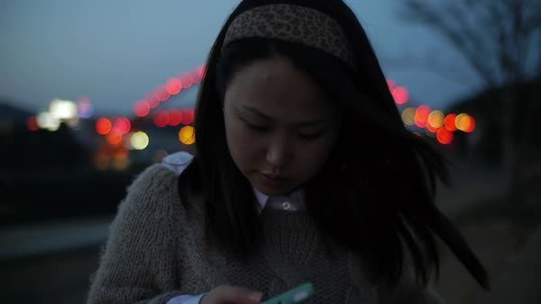 Close-up of a woman using a mobile phone in Korea Royalty-free stock video