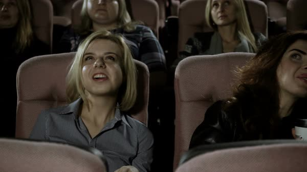 Movie theater. The enthusiastic spectators watching a movie in the cinema. Royalty-free stock video