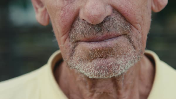 Old pensioner portrait up close. Royalty-free stock video