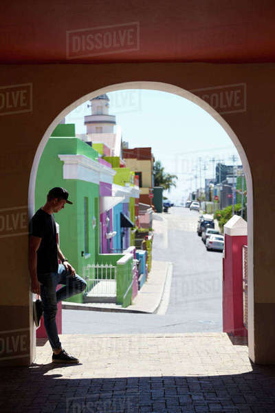 Young man standing in shaded archway, Bo Kaap, Cape Town, SA Royalty-free stock photo