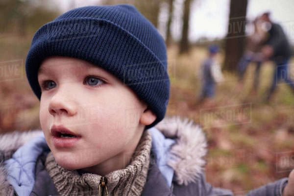 Young boy on family winter walk in countryside Royalty-free stock photo