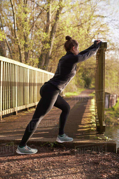 Woman Stretching During Early Morning Outdoor Run Royalty-free stock photo