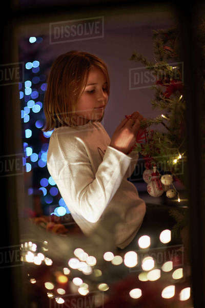 Evening Shot Of Girl At Home Decorating Christmas Tree  Royalty-free stock photo