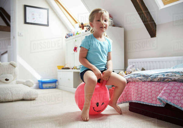 Girl Bounces On Inflatable Ball In Playroom Royalty-free stock photo