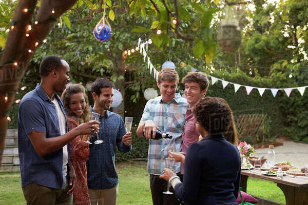 Friends Celebrating With Champagne At Outdoor Backyard Party Royalty-free stock photo