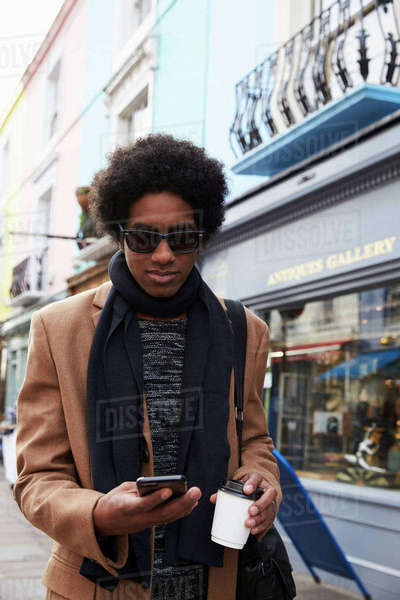 Young Man Using Phone On Busy City Street Royalty-free stock photo