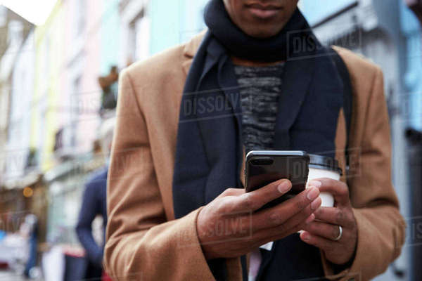 Close Up Of Man Using Phone On Busy City Street Royalty-free stock photo