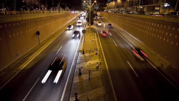 Timelapse of traffic on a road with an underpass in Barcelona Royalty-free stock video