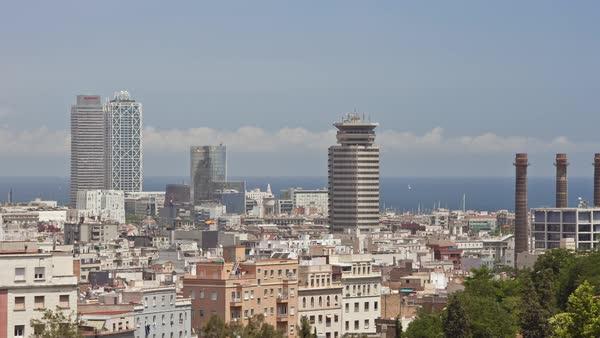 Timelapse of cityscape of Barcelona with high-rise buildings Royalty-free stock video