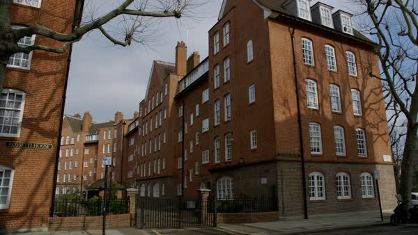 Locked-off shot of red brick apartments in London Locked-off shot of ...