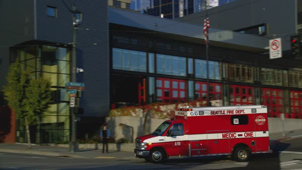 Tracking shot of an emergency vehicle turned around a corner in Seattle Rights-managed stock video