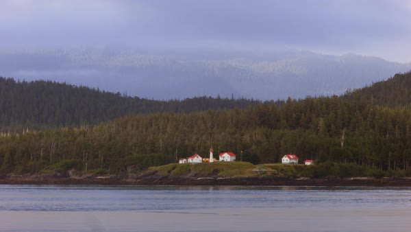 Locked-off shot of Vancouver Island with a lighthouse in Canada Rights-managed stock video