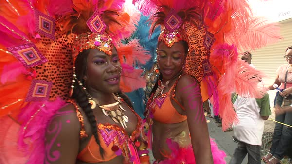 Hand-held shot of Black dancers in a carnival Rights-managed stock video