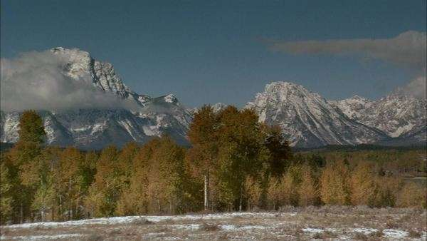 Panning shot of the peaks of Grand Teton in Yellowstone National Park Rights-managed stock video