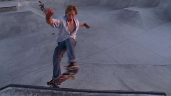 Montage of a skateboarder riding in a skate park during daytime Rights-managed stock video