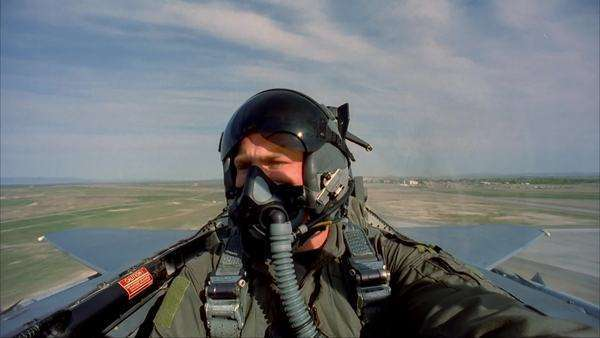 Medium shot of a pilot maneuvering in a military fighter jet Rights-managed stock video