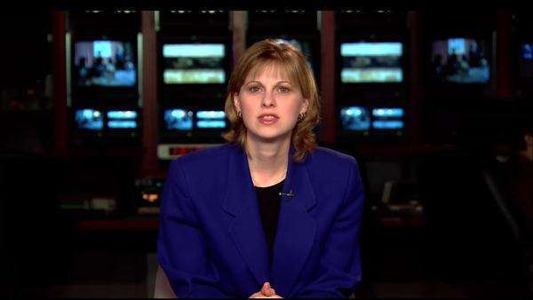 Static shot of a newscaster reporting Rights-managed stock video