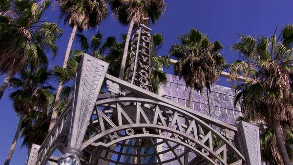 Zooming out shot of a silver Hollywood sign in Los Angeles Rights-managed stock video