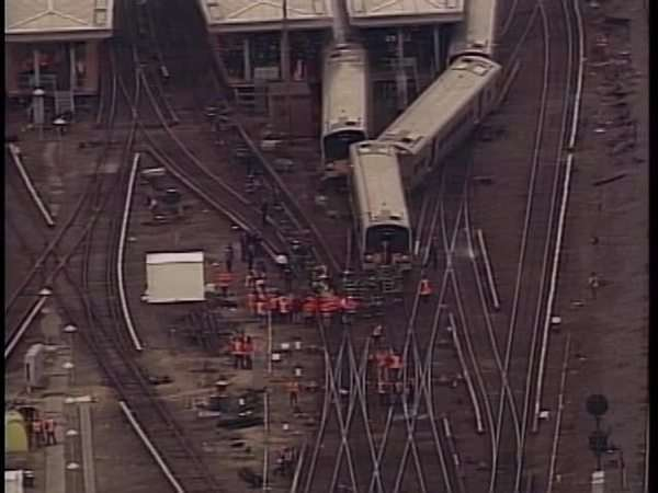 Aerial shot of rescue workers at a train crash site Rights-managed stock video