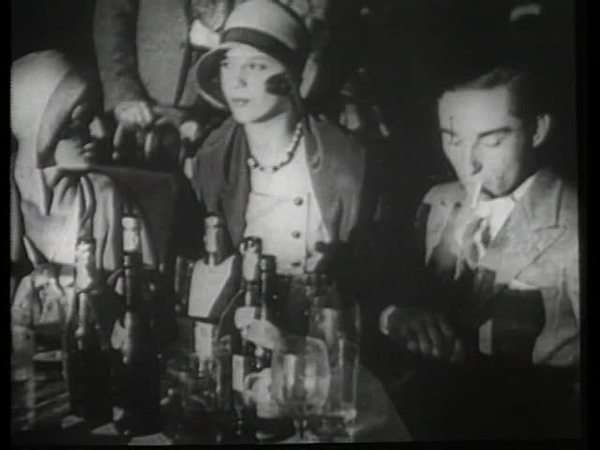 Montage of a party and a street with a trolley in 1920s Rights-managed stock video