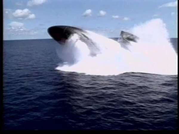 Tracking shot of a military submarine breaching surface Rights-managed stock video