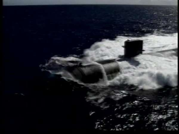 Aerial shot of a military submarine moving on surface Rights-managed stock video
