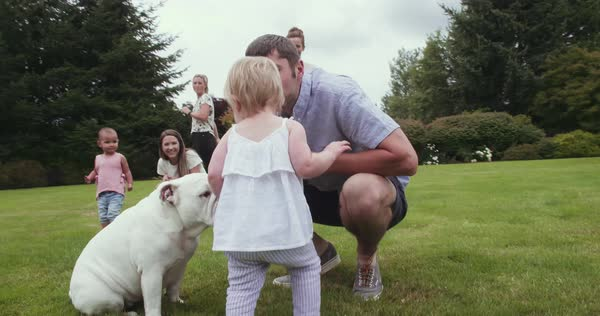 Dad and baby girl with bulldog Royalty-free stock video