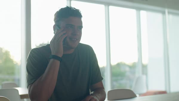 Medium shot of a young man talking on a cell phone Royalty-free stock video