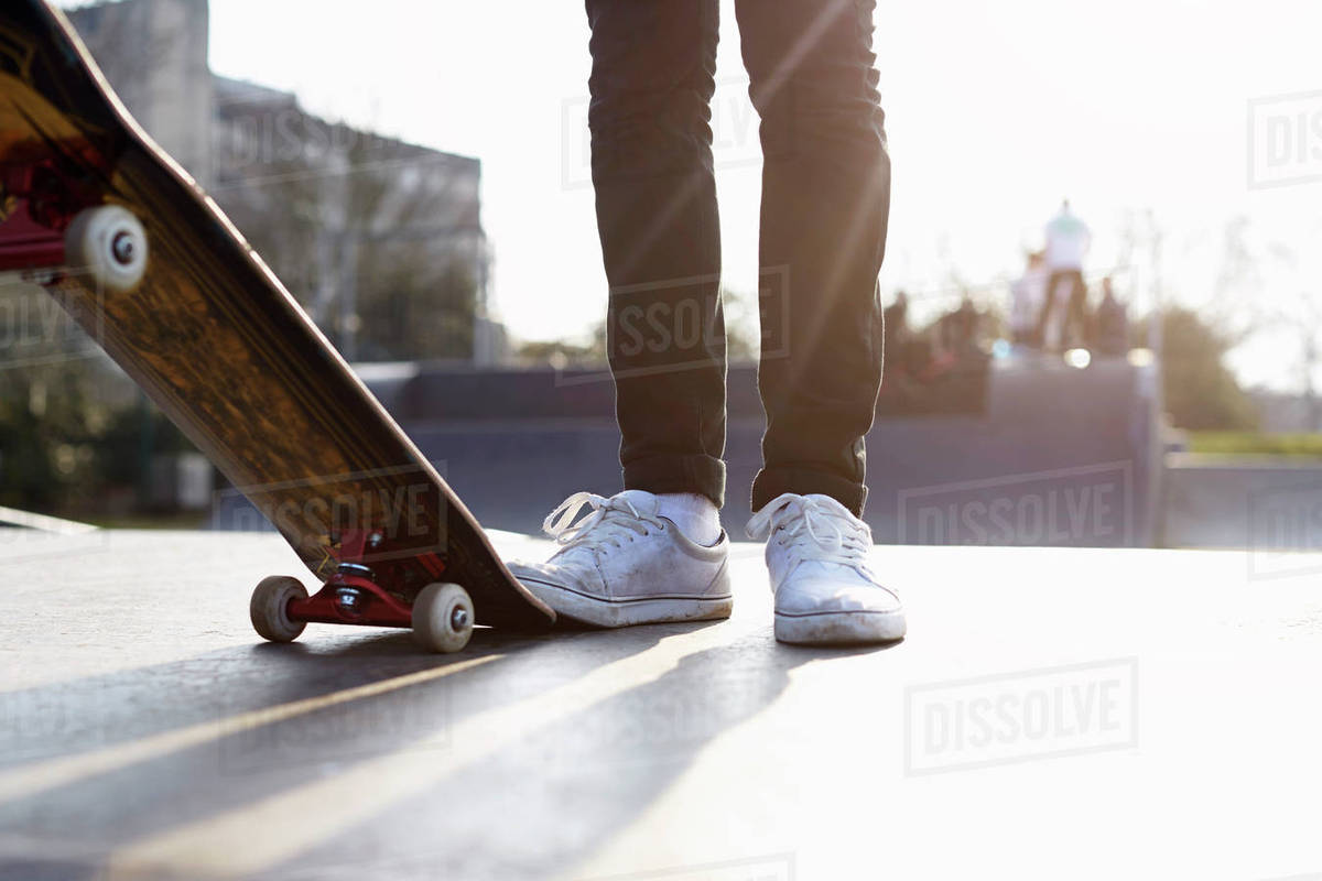 Close-up of skateboarder's feet with skateboard Royalty-free stock photo