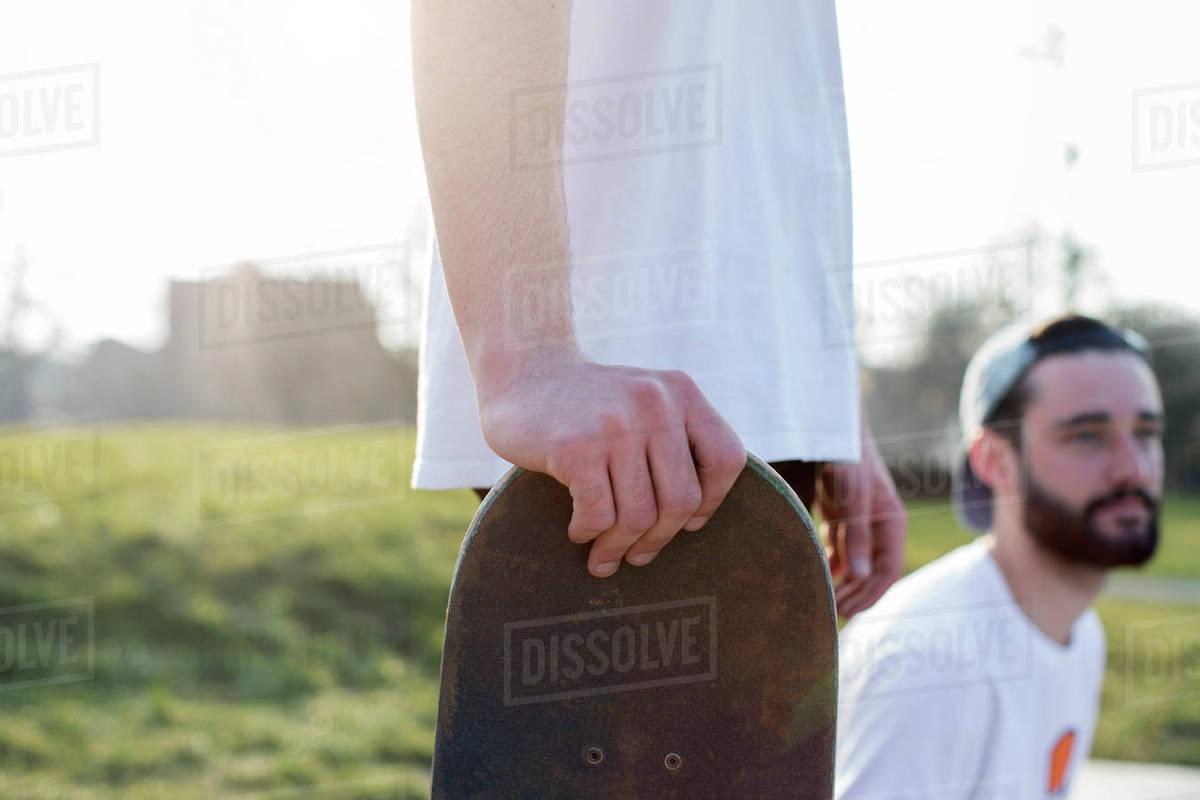 Close-up of skateboarder holding skateboard Royalty-free stock photo