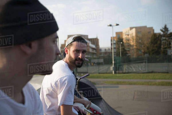 Two skateboarders hanging out in skate park together Royalty-free stock photo