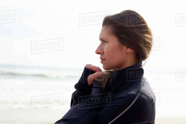 Woman on beach warming up before exercise Royalty-free stock photo