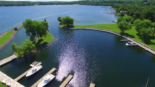 Scenic shoreline marina on beautiful sunny, windy summer day. Royalty-free stock video