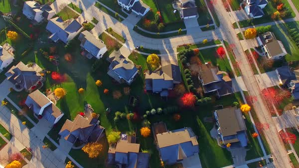 Tranquil idyllic wealthy Autumn neighborhood with frosty rooftops at sunrise, aerial view. Royalty-free stock video