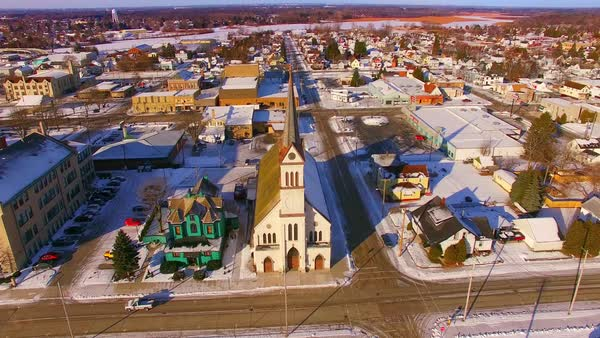 Aerial flyover of Two Rivers Wisconsin scenic Church and downtown. Royalty-free stock video