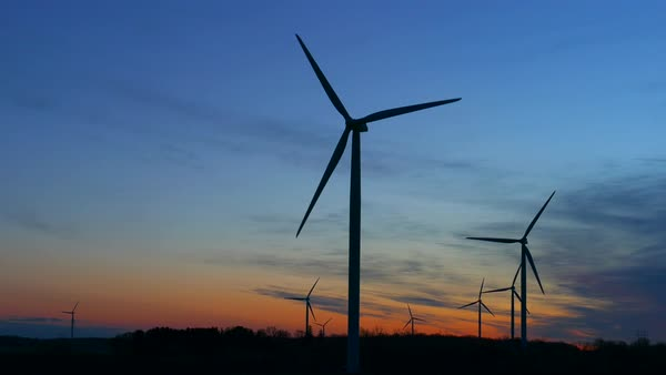 Giant wind turbines backlit by the dawn sky. Royalty-free stock video
