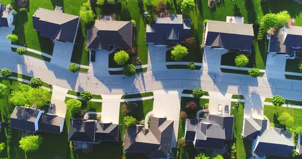 Looking straight down on beautiful suburban homes, Springtime aerial view. Royalty-free stock video