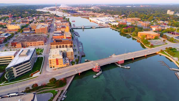 Beautiful downtown Green Bay Wisconsin with Fox River, daybreak aerial flyover. Royalty-free stock video