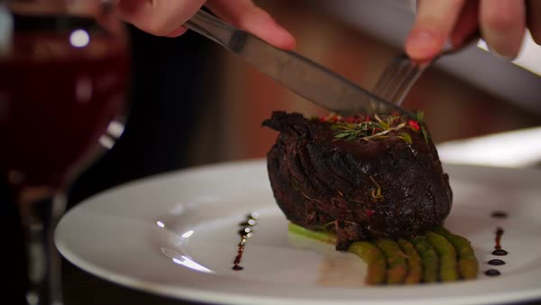 Man cuts off a piece of steak close-up Royalty-free stock video