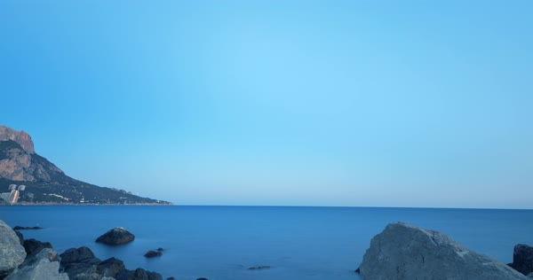 Milky Way rises. Sunset - Night - Sunrise. Cape Sarich (Golden), the southernmost point of the Crimea. Time Lapse. Royalty-free stock video