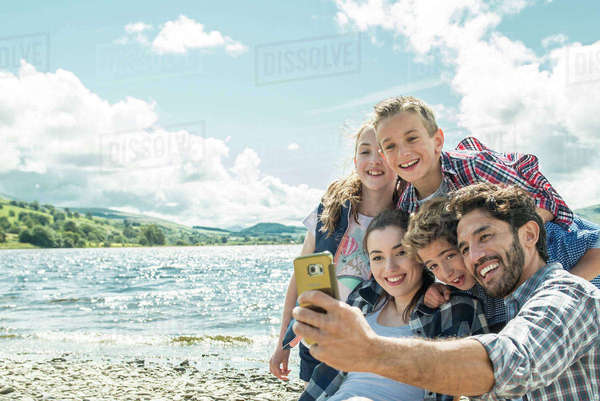A family of five taking a selfie on the shore beside Bala Lake in Wales Royalty-free stock photo