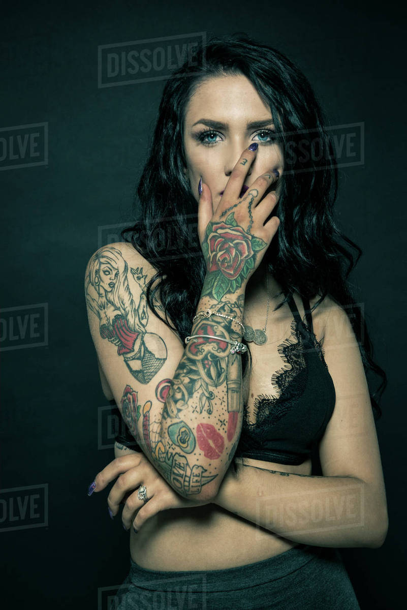 96e0ddce5 Studio portrait of a young woman with tattooed arms - Stock Photo ...