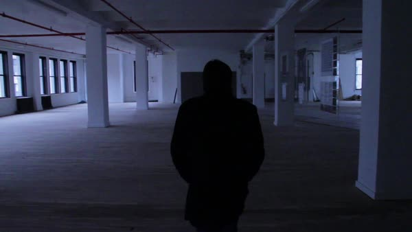 Close-up shot of man entering empty loft office Royalty-free stock video